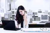 Tired businesswoman in office — Stock Photo
