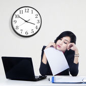 Tired young businesswoman — Stock Photo