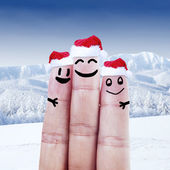 Finger dressed in Santa-Claus hats — Stock Photo