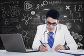Male doctor working with laptop — Stock Photo