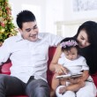 Stockfoto: Family using digital tablet