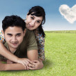 Young Couple Lying On Green Grass — Stock Photo
