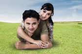 Young couple lying on grass — Stock Photo