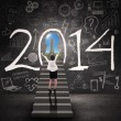 Businesswoman getting success in new year 2014 — Stock Photo