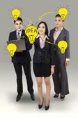 Businesswoman drawing light bulb — Stock Photo