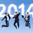 Excited businesspeople jumping on the sky — Stock Photo #38678871