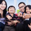 Happy family pointing at you — Foto Stock