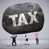 Concept of business team getting weight taxes — Stockfoto
