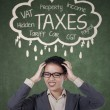 Stressed businesswoman for paying her taxes — Stock Photo