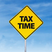 Tax time road sign — Stock Photo