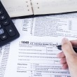 Filling the tax form — Stock Photo #39077509