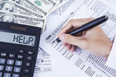 Accountant filling the tax forms — Stock Photo