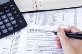 Filling the tax form — Stock Photo