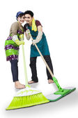 Happy couple cleaning the floor isolated — Stock Photo