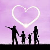 Happy family with heart symbol — Stock Photo