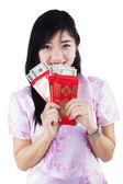 Woman holding red packet gift — Stock Photo