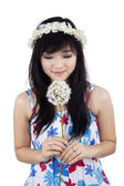 A woman smelling flower — Stock Photo