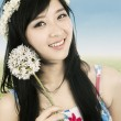 Stock Photo: Cheerful woman with crown of flower