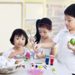 Children painting easter eggs — Stock Photo #39544275