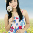 Cute woman holding flower outdoors — Stock Photo