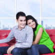 Happy couple relaxing on couch at home — Stock Photo #39547565