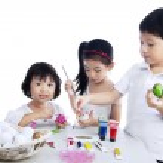 Happy children painting easter eggs — Stock Photo