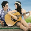 Stock Photo: Romantic couple playing guitar together