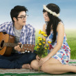 Man playing guitar for his girlfriend — Stock Photo #39549609
