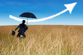 Businesswoman jumping to blue sky — Stock Photo