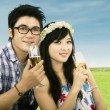 Young couple drinks wine — Stock Photo #39550603