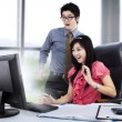 Shocked couple in front of computer — Stock Photo