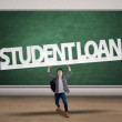 Student hold a student loan sign — Stock Photo