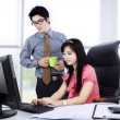 Two co-workers working together — Stock Photo #40005491