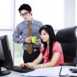 Two co-workers working together — Stock Photo