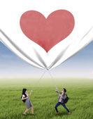 Students pulling valentine banner — Foto de Stock