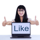 Young student with like button — Stock Photo