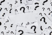 Blank paper with question marks — Stock Photo