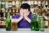 Alcoholic man in a bar — Stock Photo