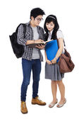 Couple students reading a book — Stock Photo