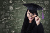 Female student in an academic gown — Stock Photo