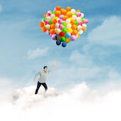 Man with colorful balloons — ストック写真
