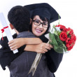 Woman celebrating graduation day with her boyfriend — Stock Photo