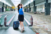 Beautiful woman on the airport — Stock Photo