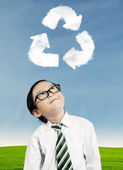 Boy looking at recycle symbol — Stock Photo