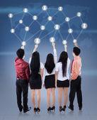 Businessteam pushing social network — Stock Photo