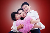 Happy family together on red — Stock Photo