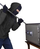 A burglar is opening safety box — Stock Photo