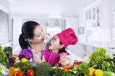Happy family preparing to cook — Stock Photo
