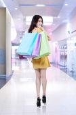Happy shopper holding shopping bags — Stock Photo