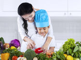 Little boy cooking with mother — Stock Photo
